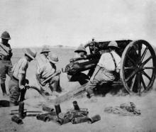 The splendid work of the British field batteries in the war: An 18-pounder in action in the...