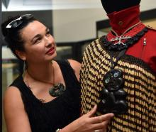 Dunedin fashion designer Amber Bridgman adjusts an ensemble she has created, at the Toitu Otago...