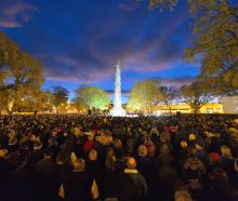 Dawn breaks over the cenotaph as a large crowd commemorates the centennial of the Gallipoli landings in 2015. Photo: Gerard O'Brien