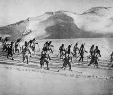 With the Italian Army: Alpine troops advancing over snow-covered ground in mountainous country. -...