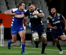 Highlanders flanker Liam Squire will miss a further six weeks with a broken thumb. Photo: Getty...