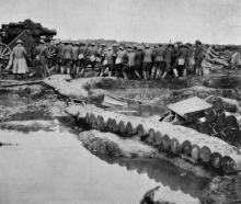 Moving up a heavy gun through the shell-shattered ground on the British Western Front. — Otago...