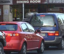 Frustrated motorists queue at a red light at the intersection of lower Stuart St and the one-way...