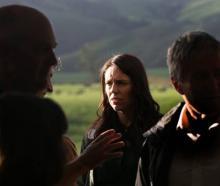Prime Minister Jacinda Ardern meets farmers on a property near Te Awamutu this morning. Photo: NZ...