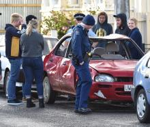 Police inspect the damaged vehicle on Hyde St. Photo: Peter McIntosh