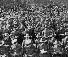 The scene in the Queen's Gardens, Dunedin, on Anzac Day, showing the gathering of returned troops...