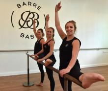 Georgia O'Malley, Phoebe Begg and Caoimhe Finn work out at Barre Base in Crawford St. PHOTO:...