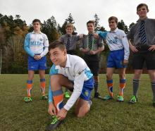 Tying up his laces is referee Logan Whitty (15) while in behind are fellow Otago Boys' High...