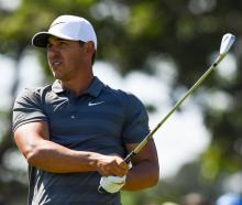 Brooks Koepka tees off the seventh hole during the final round of the US Open at Shinnecock Hills...