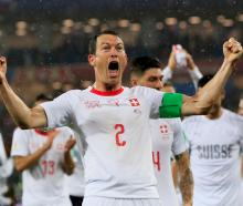 Switzerland players celebrate their victory over Serbia. Photo: Reuters