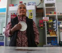 Old Town Store owner Utia Lafita holds the saucer she used to scare off a would-be  robber. Photo...
