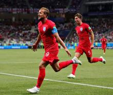 Harry Kane celebrates scoring his first of two goals for England against Tunisia this morning....