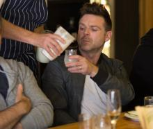 Geoff Scott serves chef Ben Bayly Pamu deer milk at a tasting event in Auckland. Photo: Lance...