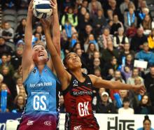 Southern Steel goal shoot Jennifer O'Connell (left) grabs the ball despite the attentions of...