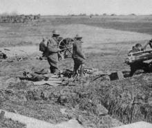 A battery of the New Zealand field artillery in action on the Somme, in France. - Otago Witness,...