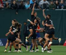 New Zealand players celebrate after winning the Championship match against France to win the 2018...