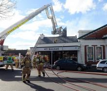 Firefighters battle the blaze on Saturday.
