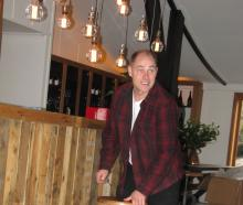 Canyon Restaurant owner Hayden Johnston sets out bar stools before welcoming his first guests....