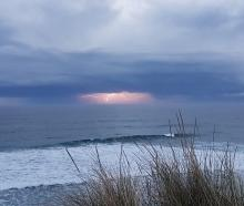 A lightning storm heads out to sea as seen from John Wilson Dr yesterday evening. Photo: Steph...