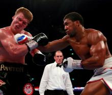 Anthony Joshua lands a right on Alexander Povetkin. Photo: Reuters