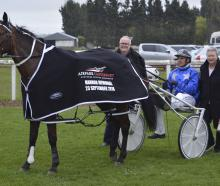 Paul Kenny  and Mary Kenny join driver Tim Williams in the birdcage after Dream About Me's win in...