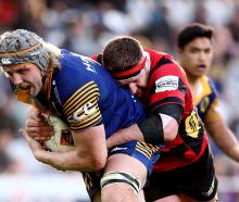 Josh Dickson, of Otago, is tackled by Chris King, of Canterbury, during a Mitre 10 Cup match at...