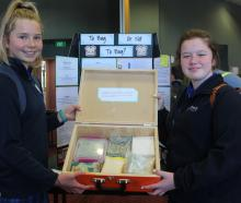Hauroko Valley Primary pupils Jendi Minty and Tayla Davey-Hubbard (both 12) present their...