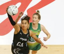 Maria Folau pulls in the ball in for the Silver Ferns as South Africa's Karla Pretorious defends...