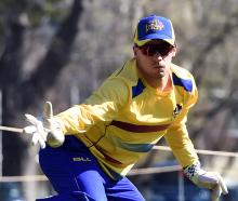 Otago wicketkeeper-batsman Mitch Renwick catches the ball during a training session at the...