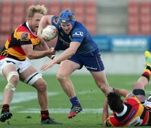 Otago loose forward James Lentjes takes on Waikato defenders James Tucker (left) and Jordan...