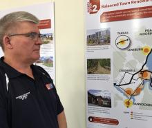 Cromwell Community Board chairman Neil Gillespie looks over one of the options for residential...