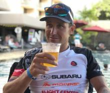 Wanaka Triathlete Braden Currie enjoys a well deserved beer after his fifth in the Ironman world...