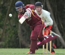 North East Valley batsman Tom Griffin drives the ball during a senior grade game at Culling Park...