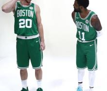 Gordon Hayward (left) and Kyrie Irving become reacquainted during a Boston Celtics Media Day...