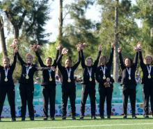 Baby Ferns players pose with their gold medals after beating France in the women's sevens final...