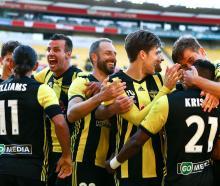 Wellington Phoenix players celebrate Roy Krishna's late winner over the Newcastle Jets. Photo:...