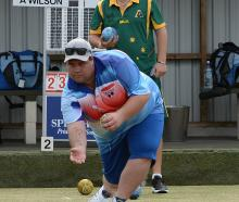 Kaikoura bowler Josh Boyd is watched by his opponent, Aaron Wilson (Australia), during the first...