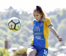 Southern United's Lara Wall has a kick around at Tonga Park after school on Thursday as she...