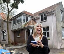 Home owner Melanie Kerr with items returned to, or found at, the Tolcarne Ave house she bought....