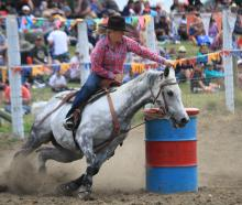 Kelly Burnett rounds a barrel during the open barrel race at the Waimate rodeo in 2015. Photo:...