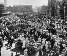 The procession and crowd celebrating German armistice day in Cathedral Square, Christchurch. -...