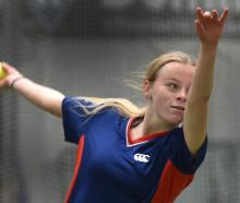 Morgan Alcock (15), of Queen's High School, bowls during the junior combined schools cricket...