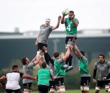 Brodie Retallick (left) and Patrick Tuipulotu contest a lineout during an All Blacks training...