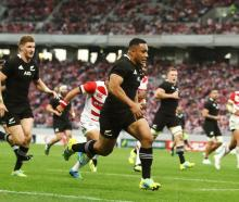 Ngani Laumape runs in a try for the All Blacks against Japan. Photo: Getty Images