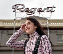 Bachelor of design student Rosette Hailes-Paku (20) models one of her designs outside  the Regent...