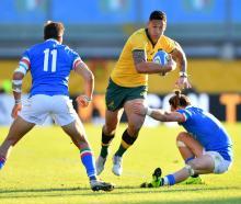 Israel Folau of Australia takes on Mattia Bellini (left) and Tommaso Benvenuti of Italy during...