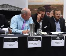 Watching proceedings at Alliance Group's annual meeting at Otago Museum yesterday are (from left)...
