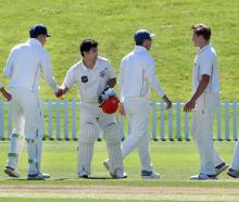 The Otago side congratulates Canterbury batsman Ken McClure yesterday morning at the conclusion...