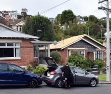 The three houses in Motu St in St Clair subject to dangerous building notices issued last night...