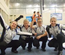 The Finnish women's curling team of (from left) Lotta Immonen, Maija Salmiovirta, Eszter Juhasz...